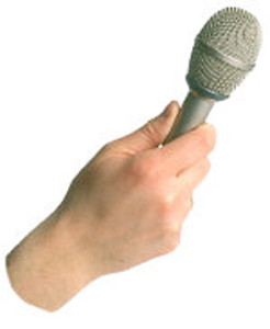 hand offering mic