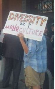 "Virginia Browning with sign at rally in support of the ""Morning Mix."""