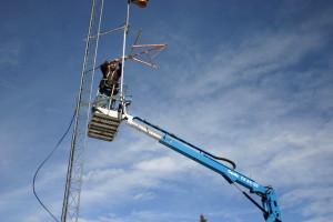 Tom Voorhees works on KDPI tower