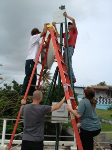 Tom Voorhees (top) WVQR Stub tower STL repeater dishes going up! Vieques in Puerto Rico, 2013.